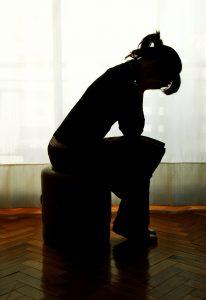 sad-girl-sitting-206x300