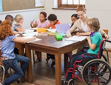 Disabled child in classroom