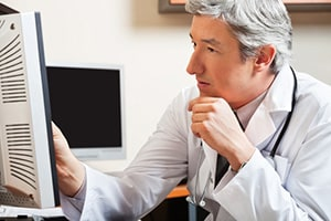Doctor Reviewing a Generic Diagnostic